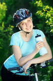 Smiling cyclist girl Royalty Free Stock Image