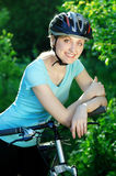 Smiling cyclist girl Stock Photos