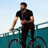 Smiling cyclist using phone Royalty Free Stock Photo