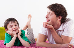 Smiling dad and son Royalty Free Stock Image