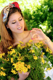 Smiling with daisies Royalty Free Stock Photos