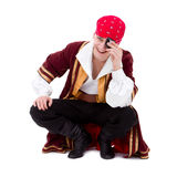 Smiling dancer dressed as pirate seated sitting Stock Image