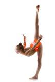 Smiling dancer girl doing standing splits. Beautiful happy gymnast athlete teenage girl wearing dancer colorful leotard working out, dancing, posing, doing stock photos