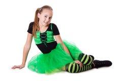 Smiling dancer in green tutu skirt sitting Royalty Free Stock Photo