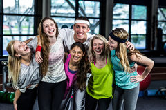 Smiling dancer group posing together. In the gym royalty free stock photo