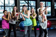 Smiling dancer group posing together. In the gym stock images