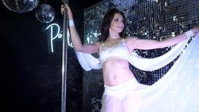 Slim flexible athletic body of beautiful sport dancer model in neon pylon party