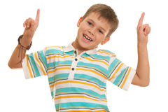 Smiling dancing kid. A smiling boy with pointers up is dancing Stock Image