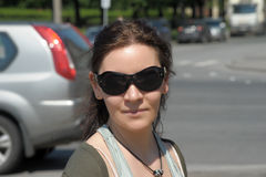 Smiling dark-haired woman in sunglasses Stock Photo