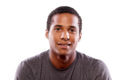 smiling dark-skinned young man Stock Image