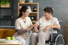 Smiling daughter and disabled mother Stock Photography