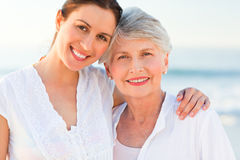 Smiling daughter with her mother. Beautiful smiling daughter with her mother Royalty Free Stock Photos