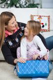 Smiling Daughter And Mother Opening Christmas Gift Royalty Free Stock Photo