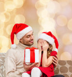 Smiling daughter waiting for present from father Stock Images