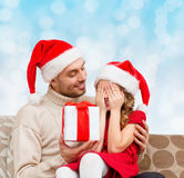 Smiling daughter waiting for present from father Royalty Free Stock Photography