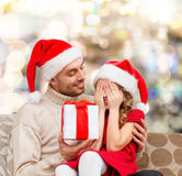 Smiling daughter waiting for present from father Royalty Free Stock Image