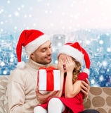 Smiling daughter waiting for present from father Stock Photos