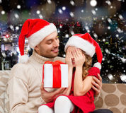 Smiling daughter waiting for present from father Stock Image