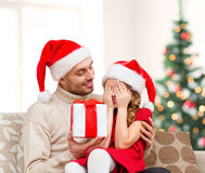 Smiling daughter waiting for a present from father Royalty Free Stock Photo