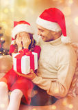 Smiling daughter waiting for a present from father Stock Image