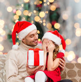 Smiling daughter waiting for present from father Royalty Free Stock Photo