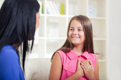 Smiling deaf girl learning sign language Stock Photography