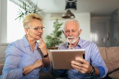 Smiling deaf senior couple talking using sign language on the digital tablet`s cam royalty free stock photography