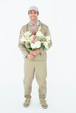 Smiling delivery man holding bouquet Stock Photo