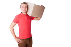 Smiling delivery man is holding a paper box Stock Photography