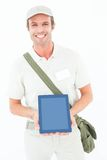 Smiling delivery man showing digital tablet Royalty Free Stock Photo
