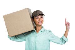 Smiling delivery woman holding box pointing up Royalty Free Stock Photo