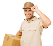 Smiling Deliveryman Carrying Cardboard Box Stock Photo