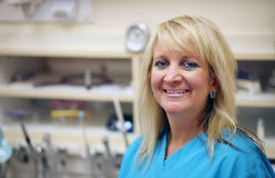 Smiling dental assistant Stock Photography