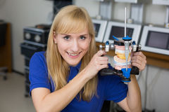 Smiling dental technician with articulator Royalty Free Stock Image