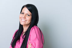 Smiling dentist assistant. On gray copyspace royalty free stock image