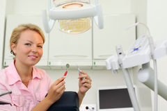 Smiling dentist sits in cabinet of dental clinic Royalty Free Stock Photos