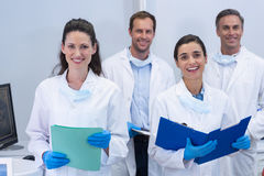 Smiling dentists standing in dental clinic stock photos