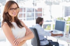 Smiling desginer standing in her office with arms crossed Royalty Free Stock Photography