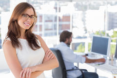 Smiling desginer standing in her office wearing glasses Stock Photo