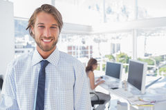 Smiling desginer standing in office Royalty Free Stock Images