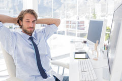 Smiling designer with arms behind head Royalty Free Stock Photos