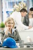 Smiling designer sitting at desk Royalty Free Stock Images