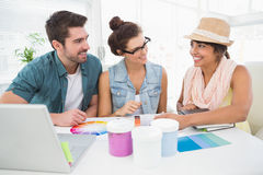 Smiling designer speaking with clients about colour chart Stock Image