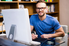 Smiling designer using tablet graphic Royalty Free Stock Photography
