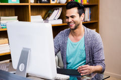 Smiling designer using tablet graphic Royalty Free Stock Photo