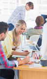 Smiling designers working on a document Royalty Free Stock Image