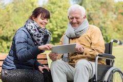 Smiling didabled man and caregiver stock photography