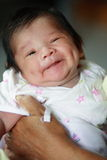 Smiling, dimpled baby. A cute young infant with dimples and a big smile Stock Photos