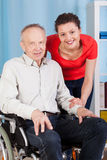 Smiling disabled man and nurse Royalty Free Stock Photography