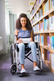 Smiling disabled student in library Stock Photos